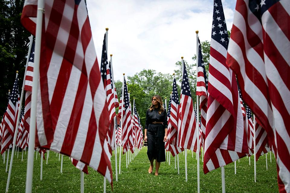 U.S. first lady Melania Trump visits a field of American flags, each flag representing a child in the foster system in Cabell County, WV, most of them due to the opioid crisis, at Ritter Park in Huntington, W.V., U.S., July 8, 2019. REUTERS/Al Drago     TPX IMAGES OF THE DAY