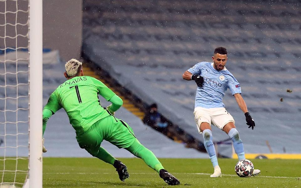 Manchester City's Riyad Mahrez scores their side's second goal of the game during the UEFA Champions League Semi Final second leg at the Etihad Stadium - Martin Rickett/PA