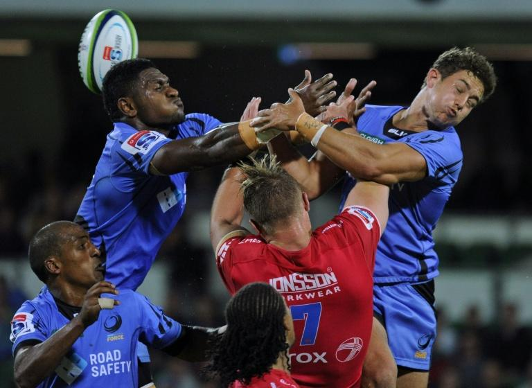 Isireli Naisarani (top-L) from Western Force loses the ball during the Super Rugby match against South Africa's Lions in Perth on April 29, 2017
