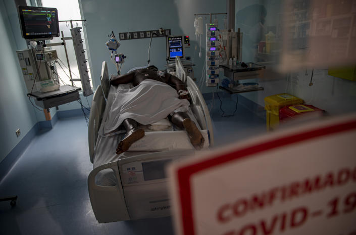A COVID-19 patient lies in the ICU of the Posta Central Hospital in Santiago, Chile, Friday, June 4, 2021. Chile's Health Ministry reported that 97% of the nation's ICU hospital beds are full, with the majority holding COVID-19 patients. (AP Photo/Esteban Felix)