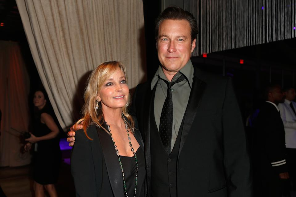 John Corbett and Bo Derek, pictured together in 2014, have been dating for 18 years. (Photo: Alvaro Cabrera/WireImage)