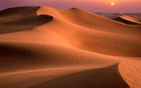 Dubai is surrounded by desert - Credit: getty