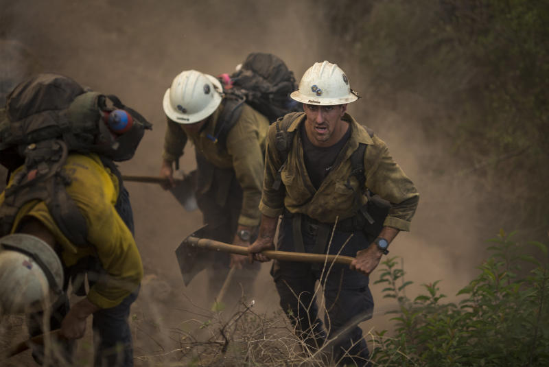 Hundreds of firefighters are still out battling the flame (David McNew via Getty Images)