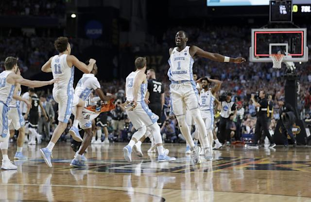<p>North Carolina players celebrate after the finals of the Final Four NCAA college basketball tournament against Gonzaga, Monday, April 3, 2017, in Glendale, Ariz. North Carolina won 71-65. (AP Photo/David J. Phillip) </p>