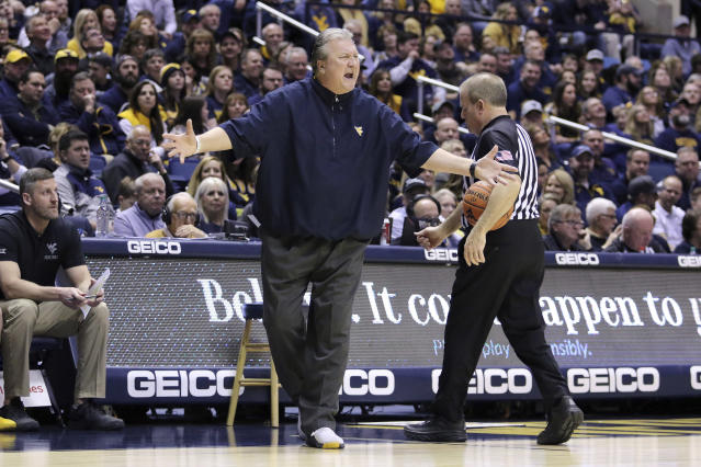 West Virginia coach Bob Huggins reacts to a call during the first half of an NCAA college basketball game against Kansas State Saturday, Feb. 1, 2020, in Morgantown, W.Va. (AP Photo/Kathleen Batten)