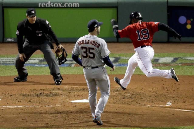 Boston Red Sox's Jackie Bradley Jr., right, scores past Houston Astros starting pitcher Justin Verlander on a wild pitch during the fifth inning in Game 1 of a baseball American League Championship Series on Saturday, Oct. 13, 2018, in Boston. (AP Photo/Elise Amendola)