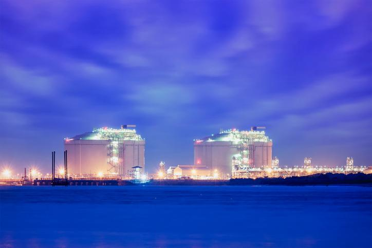 LNG storage tanks along the coast.