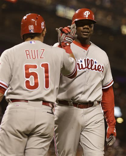 Philadelphia Phillies' Ryan Howard, right, is congratulated by Carlos Ruiz (51) after Howard hit a home run off San Francisco Giants' Jose Mijares in the ninth inning of a baseball game Tuesday, May 7, 2013, in San Francisco. (AP Photo/Ben Margot)
