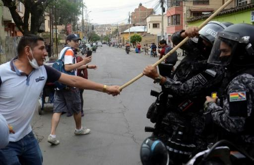 Bolivian pro-government supporters clash with riot police during a rally for President Evo Morales in Cochabamba