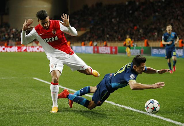 Football - AS Monaco v Arsenal - UEFA Champions League Second Round Second Leg - Stade Louis II, Monaco - 17/3/15 Arsenal's Alexis Sanchez falls in the penalty area as Monaco's Nabil Dirar looks on. Sanchez was subsequently shown a yellow card for simulation Action Images via Reuters / John Sibley Livepic EDITORIAL USE ONLY.