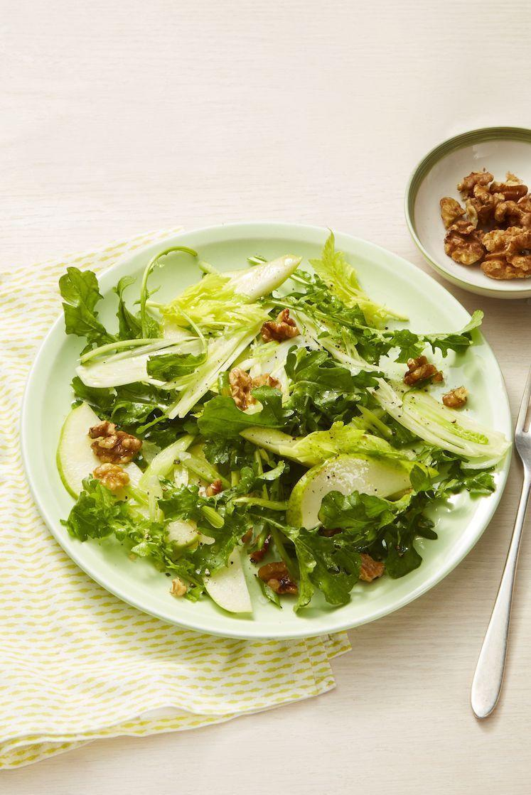 """<p>Walnuts are chock full of the antioxidants and healthy fats your body needs – and this salad is loaded with 'em. Sprinkle a little cinnamon over your walnuts before adding them to the salad for a little burst of flavor. </p><p><em><a href=""""https://www.womansday.com/food-recipes/food-drinks/a25652684/pear-and-walnut-salad-recipe/"""" rel=""""nofollow noopener"""" target=""""_blank"""" data-ylk=""""slk:Get the Pear & Walnut Salad recipe."""" class=""""link rapid-noclick-resp"""">Get the Pear & Walnut Salad recipe.</a></em></p>"""