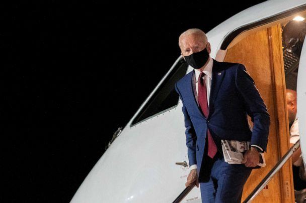 PHOTO: Democratic presidential nominee and former Vice President Joe Biden disembarks his plane at New Castle Airport upon returning from Wisconsin campaign events, in New Castle, Del., on Sept. 21, 2020. (Mark Makela/Reuters)