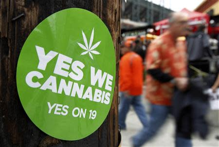 A sticker supporting legalized marijuana is seen on a power pole in San Francisco
