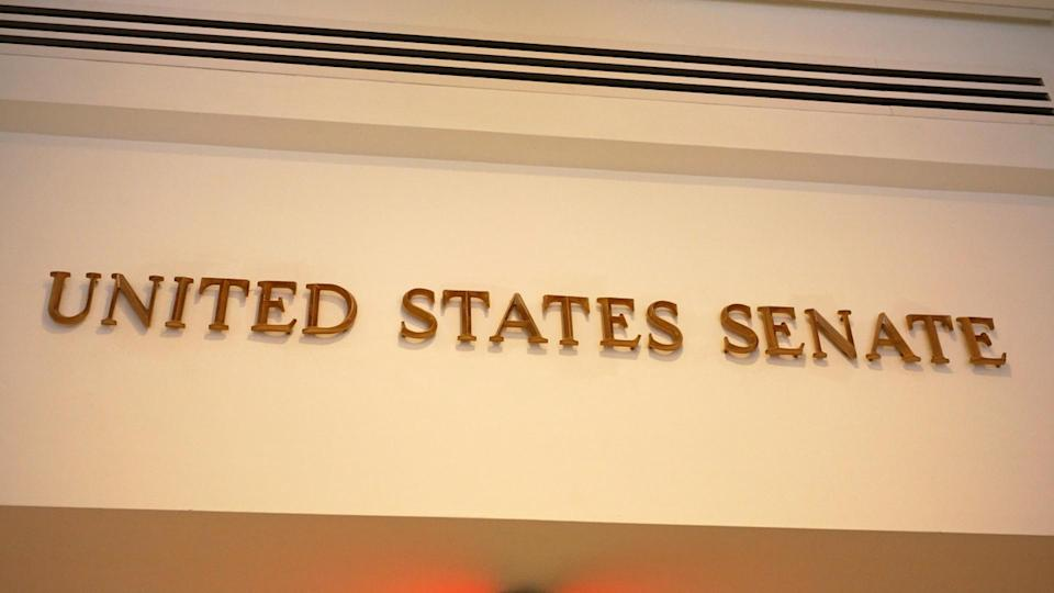 A sign marks an entrance to the United States Senate in the US Capitol building.