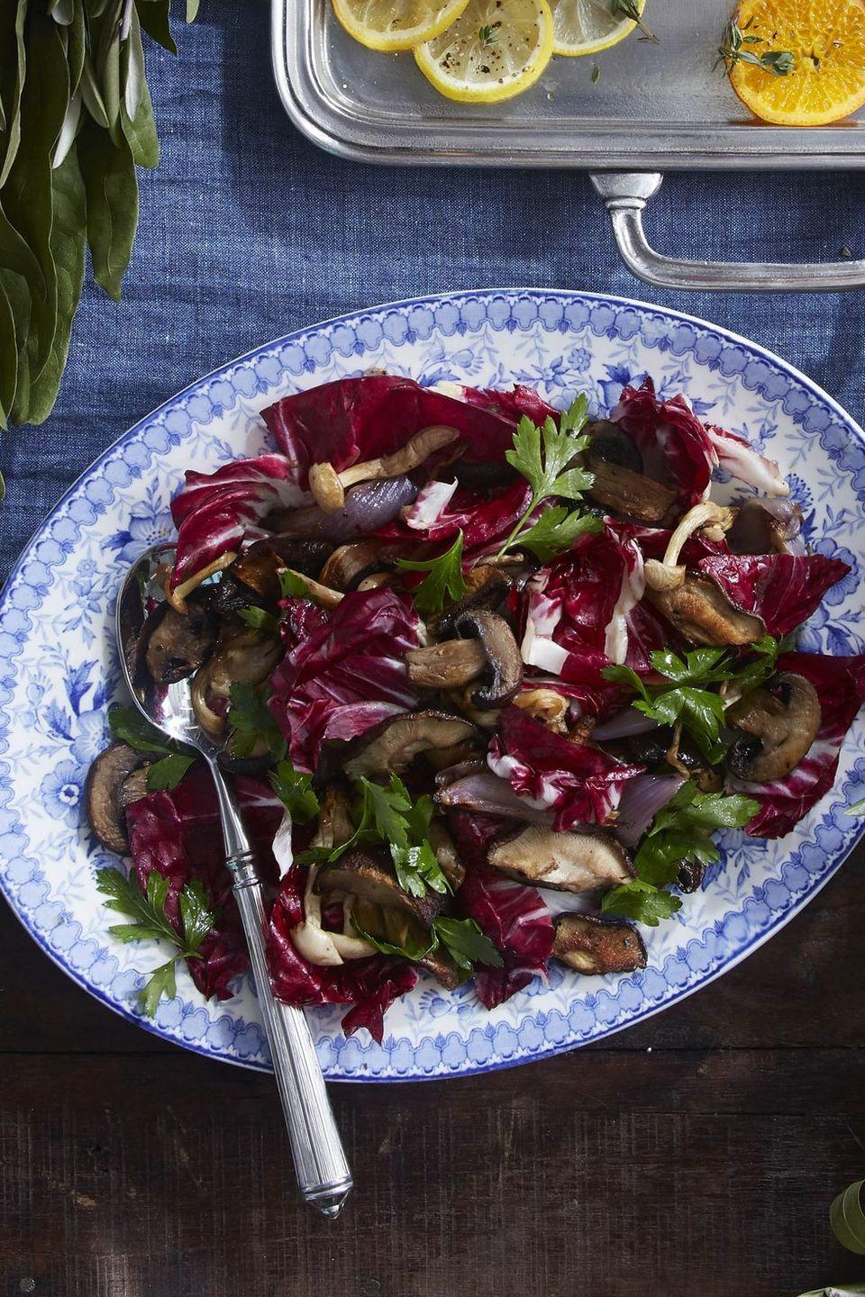 """<p>Drizzle this super simple side with balsamic or sherry vinegar to make the flavors really pop.</p><p><em><a href=""""https://www.countryliving.com/food-drinks/a34347696/roasted-mushrooms-and-radicchio/"""" rel=""""nofollow noopener"""" target=""""_blank"""" data-ylk=""""slk:Get the recipe from Country Living »"""" class=""""link rapid-noclick-resp"""">Get the recipe from Country Living »</a></em></p>"""