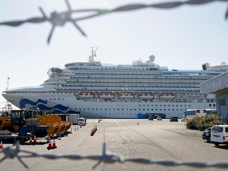The quarantined ship Diamond Princess is pictured through barbed wire at Yokohama port in Yokohama, near Tokyo: AP