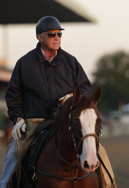 Trainer D. Wayne Lukas rides his pony on the track, Tuesday, June 4, 2013 at Belmont Park in Elmont, N.Y. Preakness winner Oxbow, trained by Likas, is entered in Saturday's Belmont Stakes horse race. (AP Photo/Mark Lennihan)