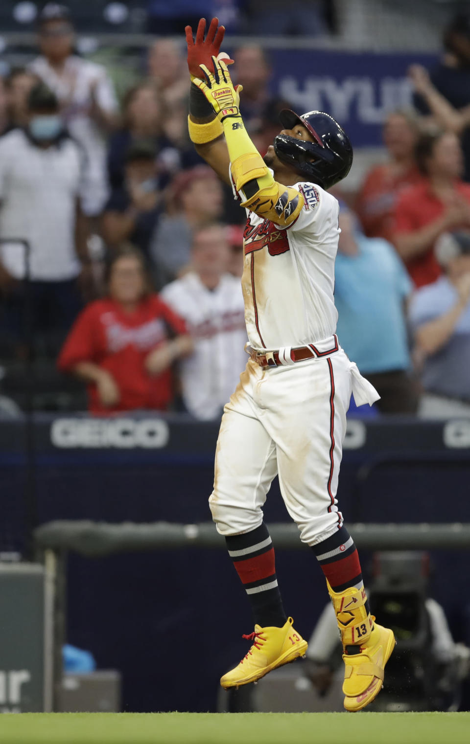 Atlanta Braves' Ronald Acuna Jr. celebrates after hitting a home run off Toronto Blue Jays pitcher Robbie Ray in the third inning of a baseball game Tuesday, May 11, 2021, in Atlanta. (AP Photo/Ben Margot)