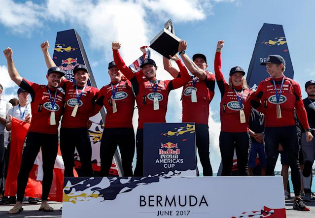 Sailing - Youth America's Cup finals - Hamilton, Bermuda - June 21, 2017 - Winners of the Youth America's Cup Land Rover BAR Academy raise trophy. REUTERS/Mike Segar