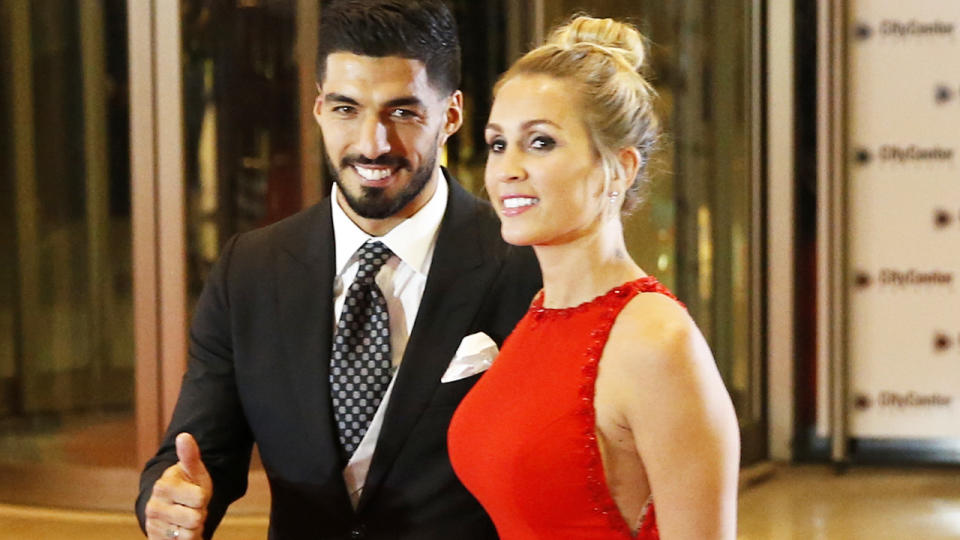 Luis Suarez and wife Sofia Balbi, pictured here at the wedding of Lionel Messi and Antonela Rocuzzo in 2017.