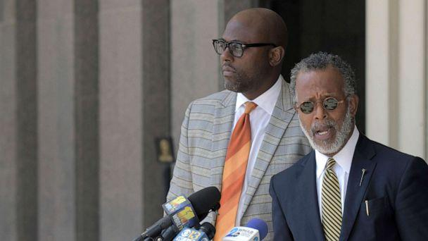 PHOTO: Defense attorneys J. Wyndal Gordon, left, and Warren Brown speak following the life sentence, meted out for 17-year-old Dawnta Harris at Baltimore County Circuit Court, Aug. 21, 2019, in Towson, Md. (Karl Merton Ferron/The Baltimore Sun via AP)