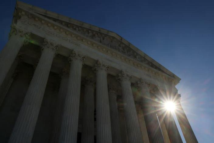The sun rises behind the U.S. Supreme Court building the day after Election Day in Washington