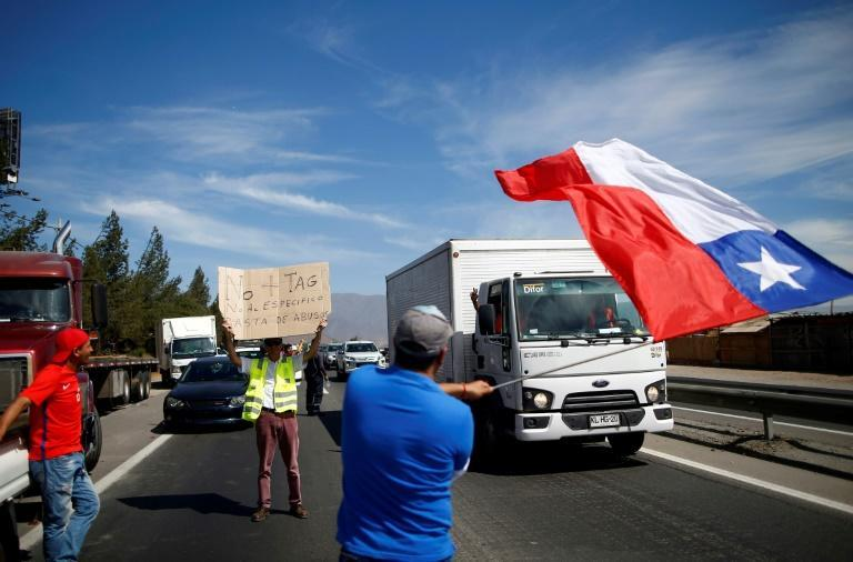 Drivers angry over toll charges demonstrate as part of protests over socio-economic woes (AFP Photo/Pablo VERA)