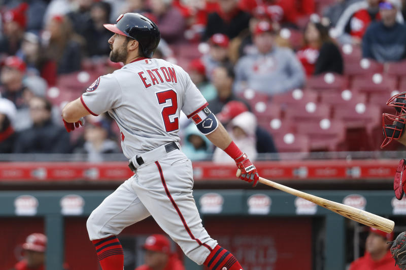The Nationals' Adam Eaton hits a two-run home run off Reds reliever Yovani Gallardo on Sunday. (AP)