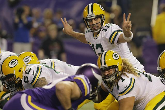 Green Bay Packers quarterback Aaron Rodgers (12) calls a play in the first half of an NFL football game against the Minnesota Vikings, Sunday, Oct. 27, 2013, in Minneapolis. (AP Photo/Ann Heisenfelt)