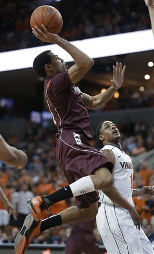 Virginia Tech guard Erick Green goes up for a basket in front of Virginia guard Jontel Evans (1) during the first half of an NCAA college basketball game Tuesday, Feb. 12, 2013, in Charlottesville, Va. (AP Photo/Steve Helber)