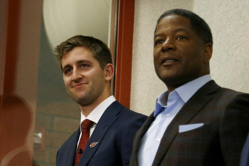 Josh Rosen, left, stands next to coach Steve Wilks, right, at Rosen's introductory news conference after the NFL draft. (AP)