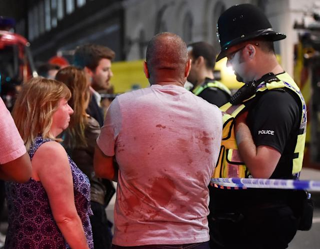 <p>People speak with police officers after an incident near London Bridge in London, Britain June 4, 2017. (Hannah Mckay/Reuters) </p>