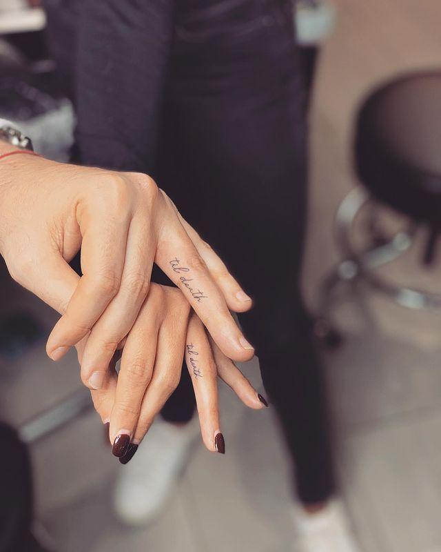 """<p>If your love is dead serious, these """"'til death"""" script tattoos on the sides of the ring fingers are made for you.</p><p><a href=""""https://www.instagram.com/p/B5iZcwzAB2Z/?utm_source=ig_embed&utm_campaign=loading"""" rel=""""nofollow noopener"""" target=""""_blank"""" data-ylk=""""slk:See the original post on Instagram"""" class=""""link rapid-noclick-resp"""">See the original post on Instagram</a></p>"""