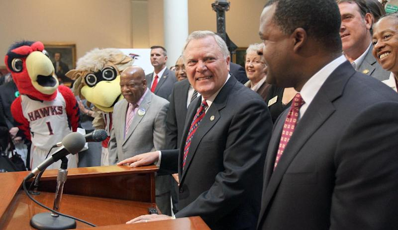 FILE - In this July 30, 2012 file photo, Georgia Gov. Nathan Deal, left, and Atlanta Mayor Kasim Reed, right, attend a press conference on a proposed transportation tax at the State Capitol in Atlanta. In this era of hyper-partisan rhetoric, the unique friendship that has developed between Deal and Reed has its roots in a shared interest in economic development and has blossomed into a powerful political alliance that is paying dividends. (AP Photo/The Atlanta Journal-Constitution, Vino Wong, File)