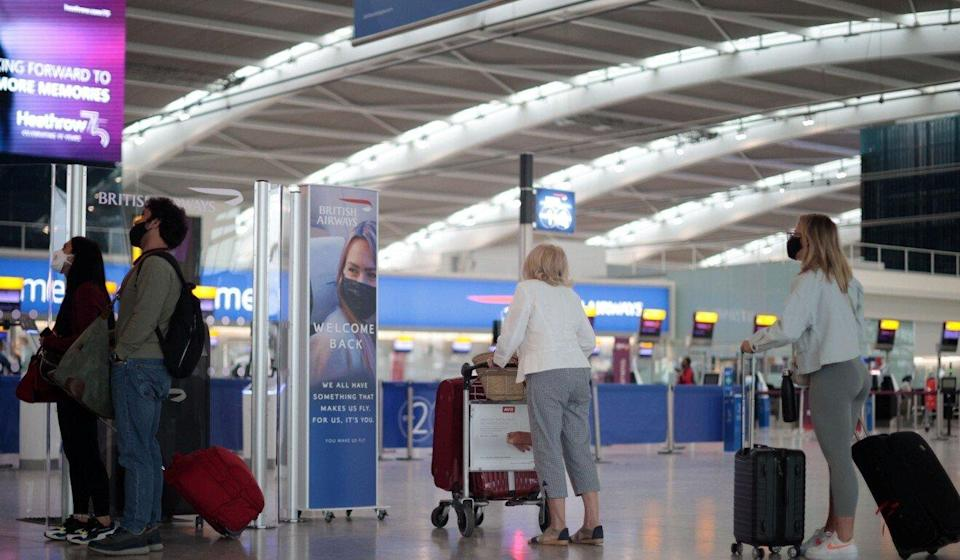 Passengers at London's Heathrow Airport. Experts are calling for arrivals into Hong Kong from Britain to be put back on 21-day quarantine regardless of vaccine status. Photo: Reuters