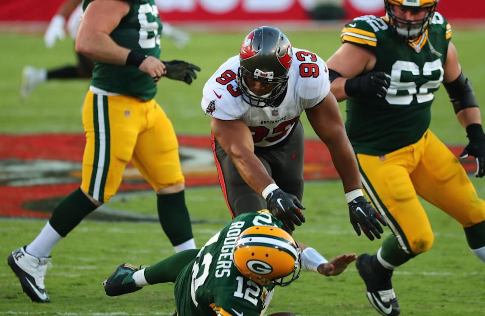 Tampa Bay Buccaneers defensive end Ndamukong Suh (93) sacks Green Bay Packers quarterback Aaron Rodgers (12) during the second quarter of a NFL game at Raymond James Stadium. Mandatory Credit: Kim Klement-USA TODAY Sports
