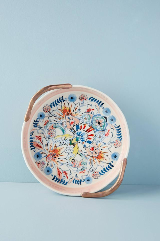 """<p><strong>Anthropologie</strong></p><p>anthropologie.com</p><p><strong>$42.00</strong></p><p><a href=""""https://go.redirectingat.com?id=74968X1596630&url=https%3A%2F%2Fwww.anthropologie.com%2Fshop%2Feres-pie-dish&sref=http%3A%2F%2Fwww.housebeautiful.com%2Fshopping%2Fg4740%2Fhousewarming-gifts%2F"""" target=""""_blank"""">BUY NOW</a></p><p>Any baker will appreciate this gorgeous pie dish, perfect for serving up their favorite dessert at their next post-housewarming party. </p>"""