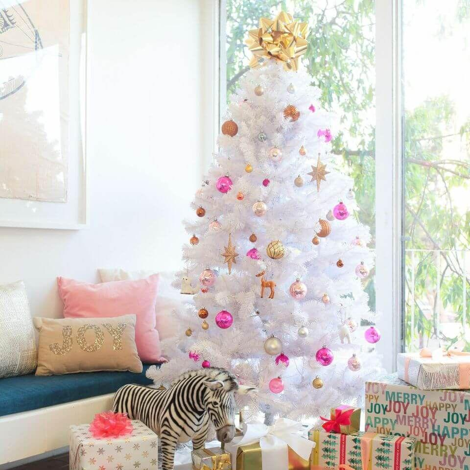 "<p>Red? For Christmas? Not even close to groundbreaking. Switch it up with pink this year. Pair pink ornaments with a fake white tree–along with a touch of gold–and you'll be set.</p><p>See more at <a href=""https://stylebyemilyhenderson.com/blog/christmas-through-the-years"" rel=""nofollow noopener"" target=""_blank"" data-ylk=""slk:Emily Henderson"" class=""link rapid-noclick-resp"">Emily Henderson</a>.</p><p><a class=""link rapid-noclick-resp"" href=""https://www.amazon.com/National-Tree-Winchester-Glitter-WCHW7-300-70/dp/B00MS7UYBI/ref=sr_1_1_sspa?dchild=1&keywords=white+christmas+tree&qid=1596681877&s=home-garden&sr=1-1-spons&psc=1&spLa=ZW5jcnlwdGVkUXVhbGlmaWVyPUE1TktHMlhKSUU5MTgmZW5jcnlwdGVkSWQ9QTAwNjYxNTFYNjI5SU9BMzVBVkkmZW5jcnlwdGVkQWRJZD1BMDQzNTE3OTM0UERWMjlZT0RWUlMmd2lkZ2V0TmFtZT1zcF9hdGYmYWN0aW9uPWNsaWNrUmVkaXJlY3QmZG9Ob3RMb2dDbGljaz10cnVl&tag=syn-yahoo-20&ascsubtag=%5Bartid%7C10057.g.505%5Bsrc%7Cyahoo-us"" rel=""nofollow noopener"" target=""_blank"" data-ylk=""slk:SHOP TREES"">SHOP TREES</a> <strong><em>White Tree, $242</em></strong></p>"
