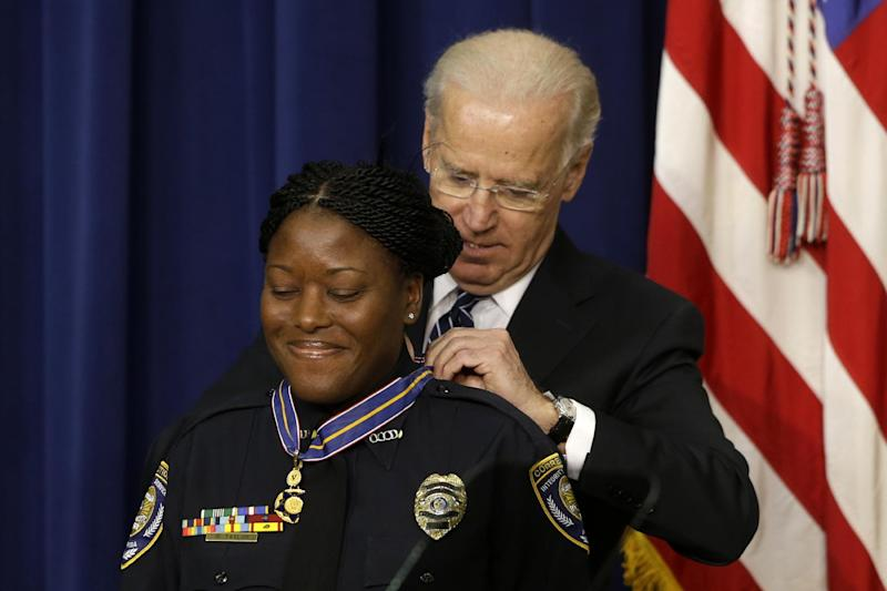 Vice President Joe Biden presents the Medal of Valor to Officer Reeshemah Taylor of the Osceola County Corrections Department in Florida., Wednesday, Feb. 20, 2013, during a ceremony in the Eisenhower Executive Office Building on the White House complex in Washington. The medal is the highest national award for valor by a public safety officer. The medal is awarded to public safety officers who have exhibited exceptional courage, regardless of personal safety, in the attempt to save or protect human life. (AP Photo/Charles Dharapak)