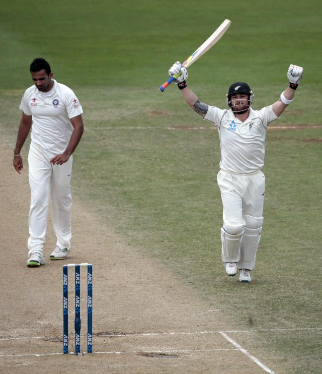 New Zealand's Brendon McCullum (R) acknowledges his 300 next to India's Zaheer Khan during the second innings of play on day five of the second international test cricket match at the Basin Reserve in Wellington, February 18, 2014. REUTERS/Anthony Phelps (NEW ZEALAND - Tags: SPORT CRICKET)