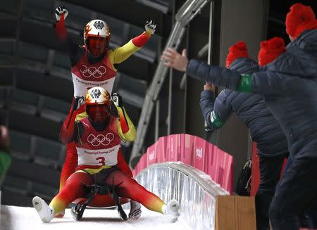 Luge - Pyeongchang 2018 Winter Olympics - Men's Doubles Competition - Olympic Sliding Centre - Pyeongchang, South Korea - February 14, 2018. Tobias Wendl and Tobias Arlt of Germany celebrate winning gold. REUTERS/Edgar Su