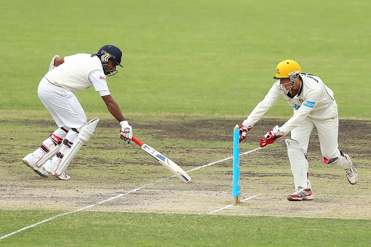 CANBERRA, AUSTRALIA - DECEMBER 07:  Sam Whiteman of the Chairman's XI attempts to run out Mahela Jayawardene of Sri Lanka during day two of the international tour match between the Chairman's XI and Sri Lanka at Manuka Oval on December 7, 2012 in Canberra, Australia.  (Photo by Brendon Thorne/Getty Images)