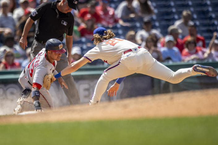 Washington Nationals' Starlin Castro (13) is safe at third before Philadelphia Phillies third baseman Alec Bohm (28) can make the tag during the sixth inning of a baseball game, Wednesday, June 23, 2021, in Philadelphia. (AP Photo/Laurence Kesterson)