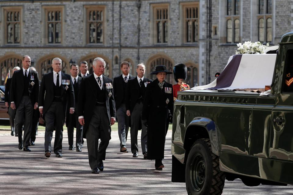 From front left, Britain's Prince Charles, Princess Anne, Prince Andrew. Prince Edward, Prince William, Peter Phillips, Prince Harry, Earl of Snowdon and Tim Laurence follow the coffin in a ceremonial procession for the funeral of Britain's Prince Philip inside Windsor Castle in Windsor.