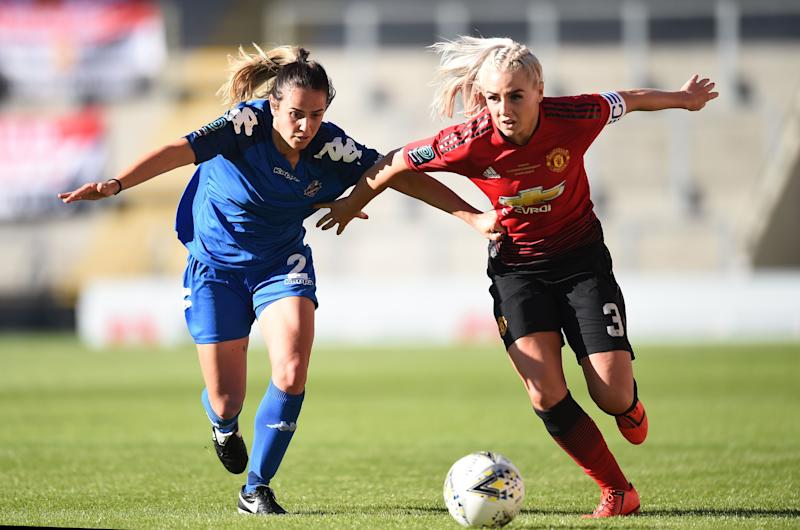 Alex Greenwood of Manchester United Women and Charley Boswell of Lewes Women