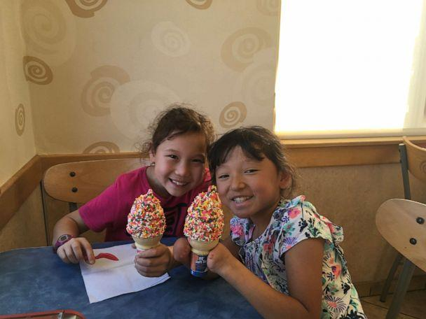 PHOTO: Sara Hinesley, right, enjoys an ice cream cone with her older sister, Veronica Hinesley. (Cathryn Hinesley)