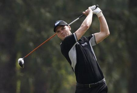 Kaymer of Germany watches his tee shot on the 18th hole during the second round of the U.S. Open Championship in Pinehurst