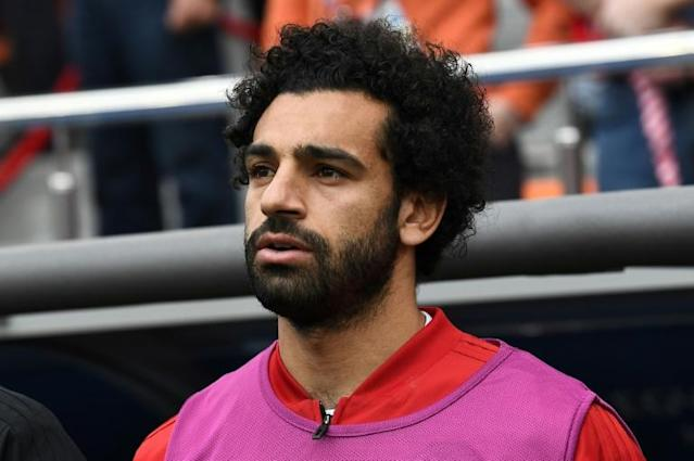 Egypt's forward Mohamed Salah is seen by the substitutes bench before kick off of the Russia 2018 World Cup Group A football match between Egypt and Uruguay at the Ekaterinburg Arena in Ekaterinburg (AFP Photo/Anne-Christine POUJOULAT )