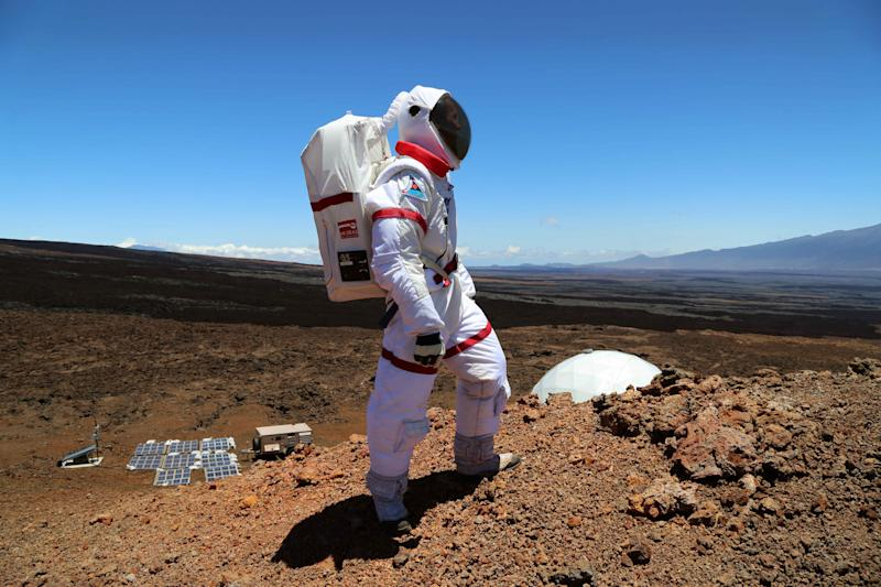 In this June 4 2013 photo provided by the University of Hawaii, research space scientist Oleg Abramov walks outside simulated Martian base at Mauna Loa, Hawaii. Six researchers have spent the past four months living in a small dome on a barren Hawaii lava field at 8,000 feet, trying to figure out what foods astronauts might eat on Mars and during deep-space missions. (AP Photo/University of Hawaii, Angelo Vermeulen)