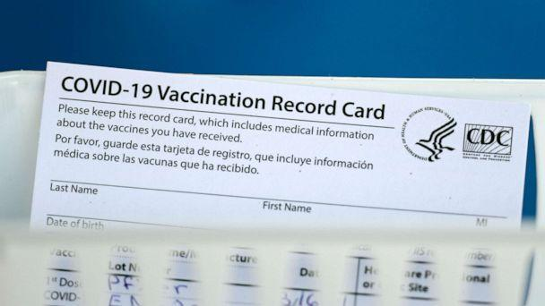PHOTO: A vaccination record card is shown during a COVID-19 vaccination drive for Spring Branch Independent School District education workers Tuesday, March 16, 2021, in Houston. School employees who registered were given the Pfizer vaccine. (David J. Phillip/AP)
